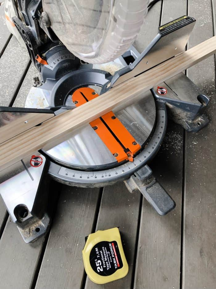 Using a miter saw to cut the frame for my farmhouse sign.
