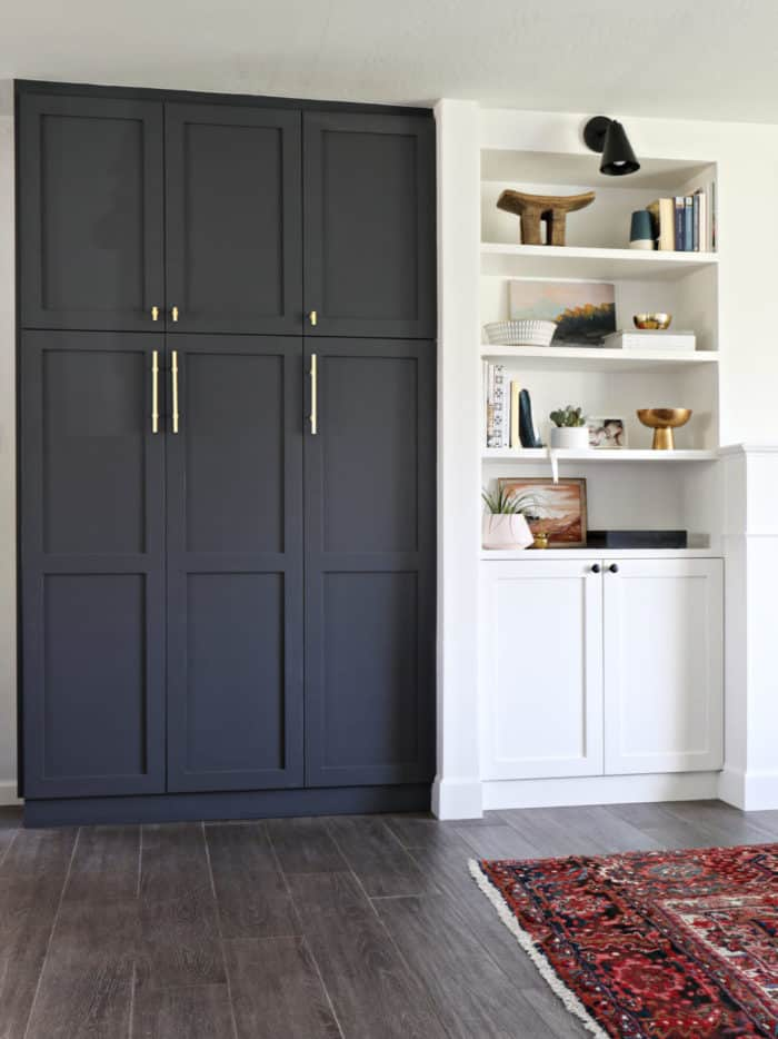 IKEA Hack, taking the Pax wardrobe and creating a pantry from it. Also painting it a stunning dark gray color white pops off all the other white cabinetry.