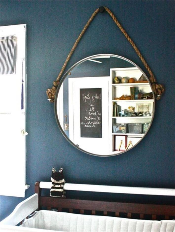 Ikea hack, taking a mirror and adding eye bolts and rope to create a nautical hanging mirror.