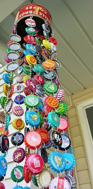 This is a wind chime made with a soup can and hanging bottle caps of various colors.
