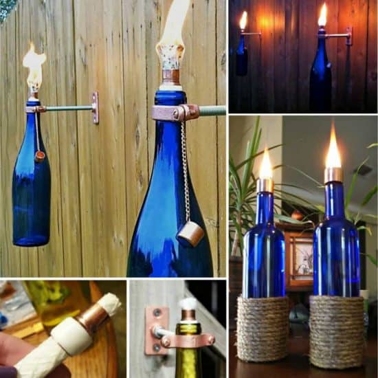 Wine bottles made into tick torches and hung on a fence.