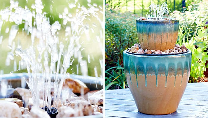 A DIY water fountain using stacked pots and rocks.