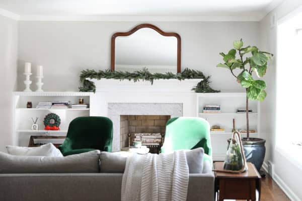 Agreeable Gray Greige Paint Color in a family room with a white mantel on a fireplace and built-ins on either side.