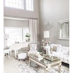 Amazing Gray Greige Paint Color in a family room with vaulted ceilings and tons of windows.