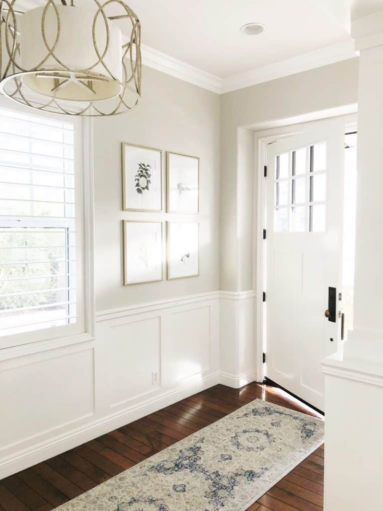 Pale Oak Greige Paint Color in an entryway with white wainscotting.