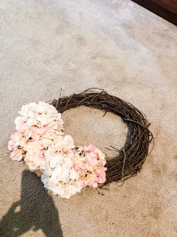 Trying different places to put the flowers on the wreath.