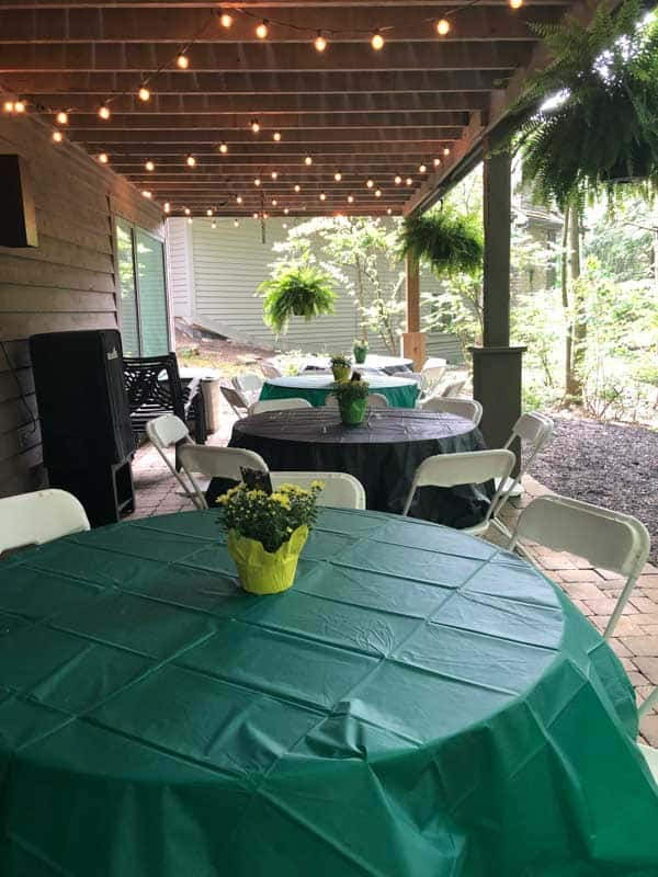 This shows the tables under the deck and the pretty centerpieces for the graduation party.