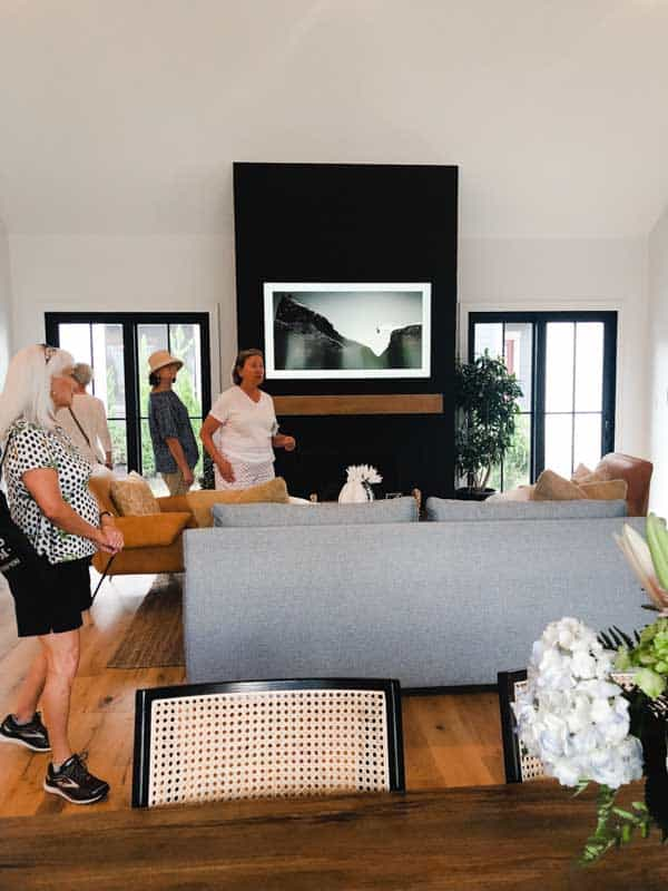 The family room with black shiplap on the fireplace.