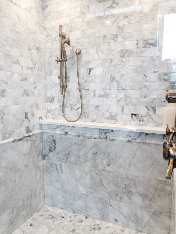 A custom marble tile shower from floor to ceiling.