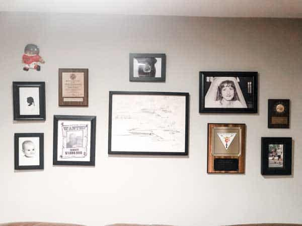 This is a gallery wall using photos, plaques and decor.