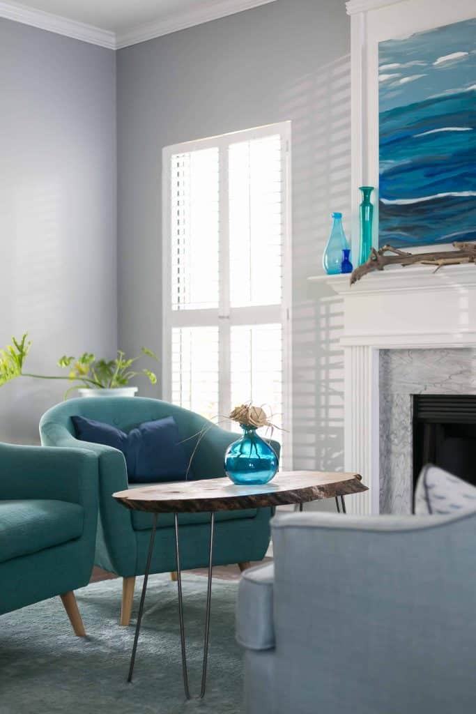 This is the color Online used in a family rom with blue green club chairs and a wood slice coffee table next to a fireplace.