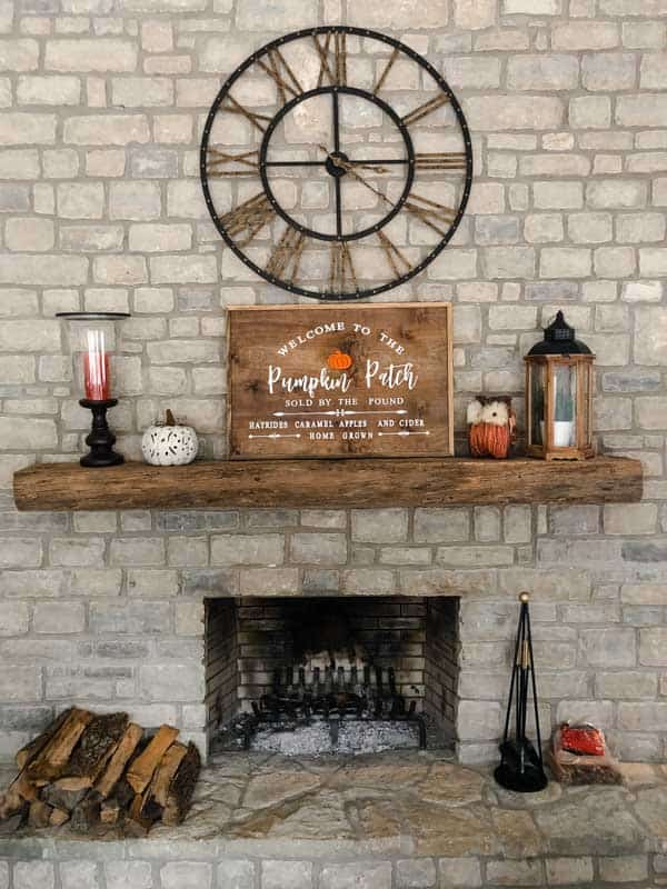 My fall mantle with a fall wood sign that says welcome to the pumpkin patch.