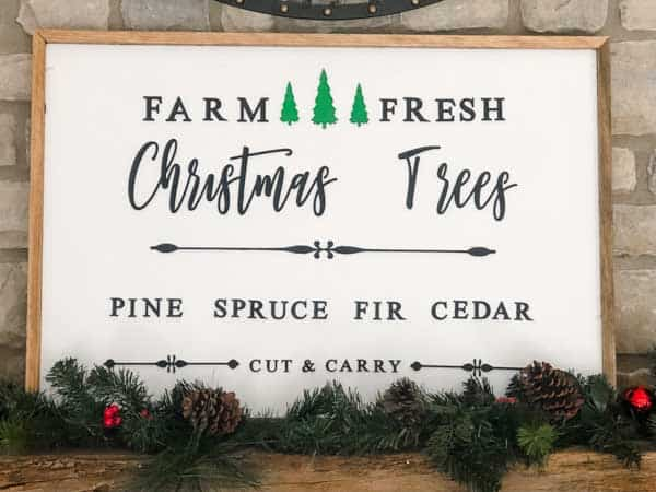 A Christmas wood sign that says farm fresh Christmas Trees.