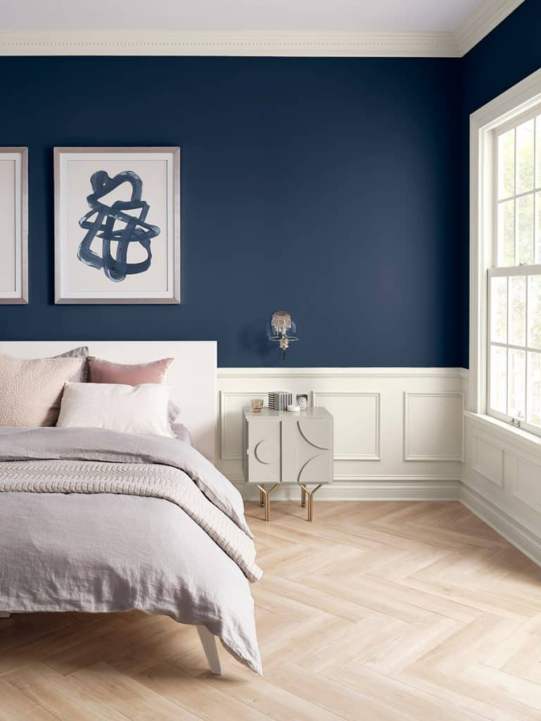 An example of Sherwin Williams Naval used in a bedroom on the walls.