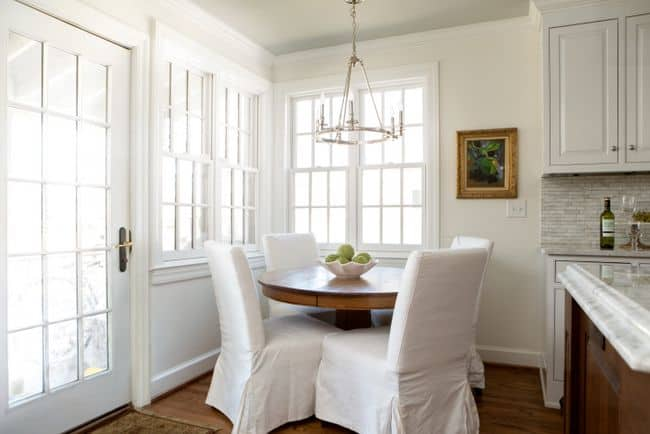 A breakfast nook with white walls and white trim.