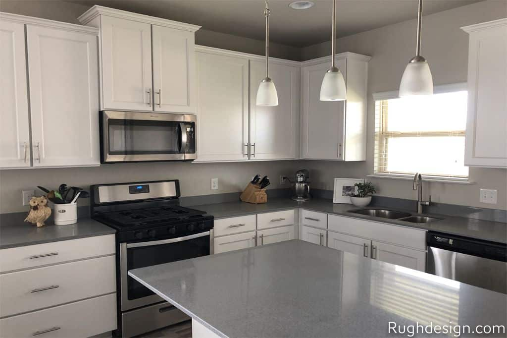 A kitchen painted with Sherwin Williams Agreeable Gray.