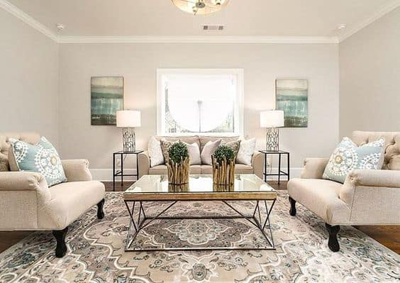 A family room with white trim and Revere Pewter on the walls.