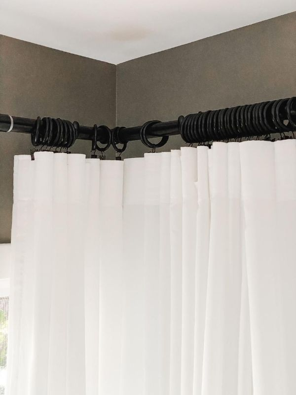 IKEA Ritva Curtains hung on rings with clips highlighting a corner curtain rod.