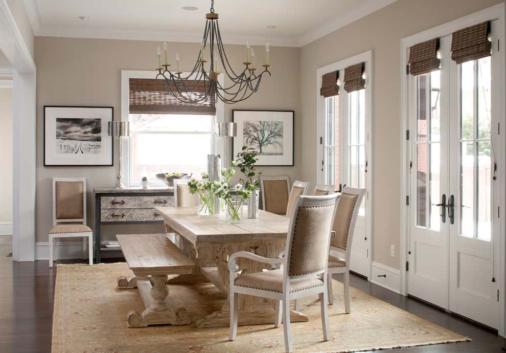 A dining room with a large black and wood chandelier with walls painted in Benjamin Moore Revere Pewter.