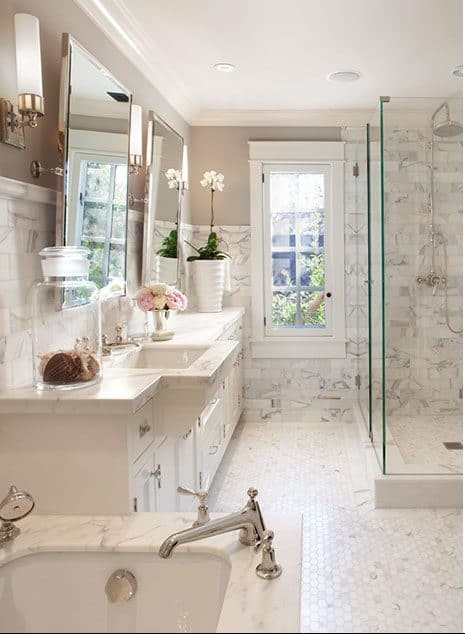 A bathroom with lots of marble on the surfaces but Revere Pewter on the walls.