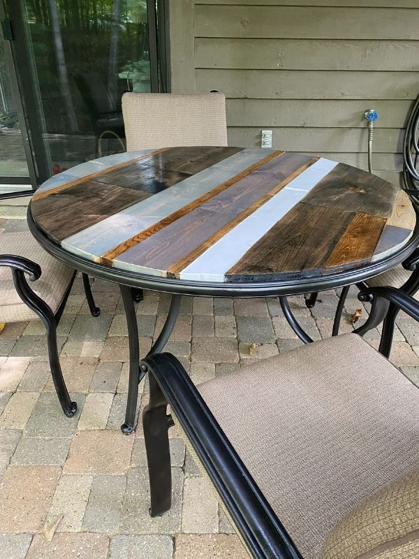 DIY patio table top using scrap wood and stained different colors.