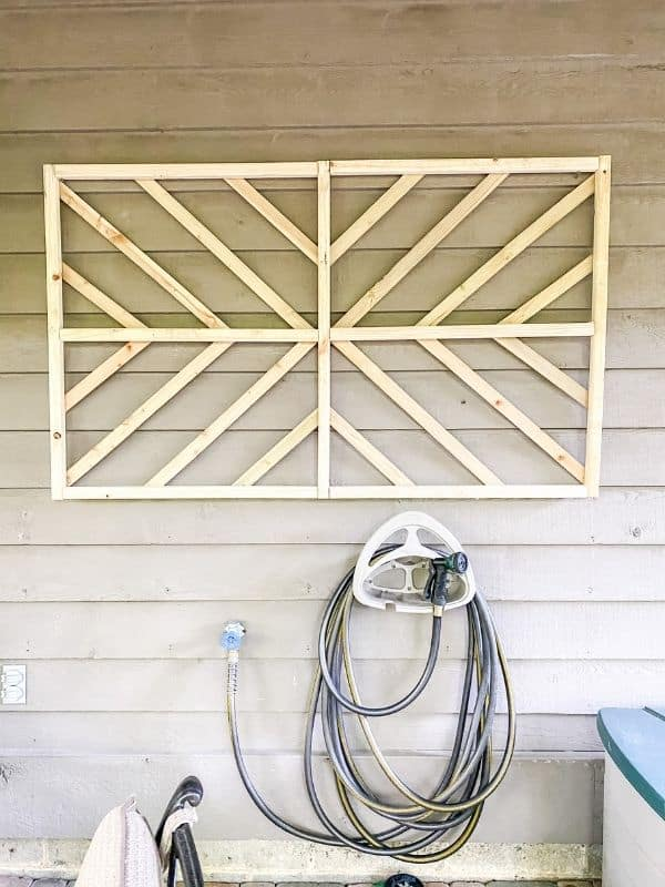 DIY wall art using pressure treated spindles and lathe to create a starburst design.