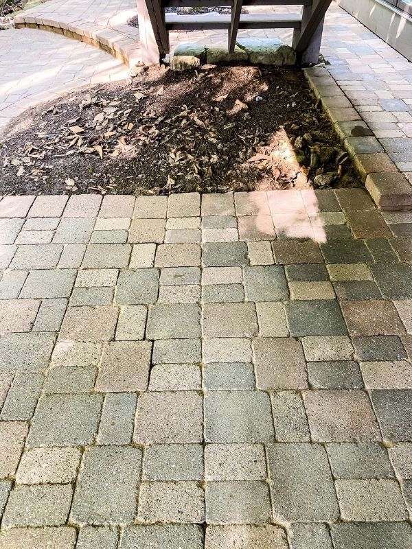The after picture of a clean paver patio.