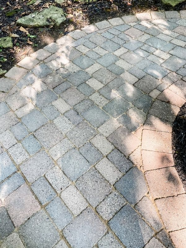 The after picture of the clean paver patio.