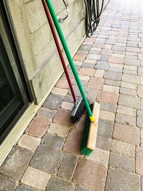 The two brooms that I have used to spread the sand.