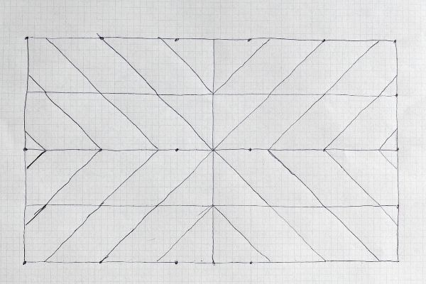The plan on graph paper of how to create the starburst design.