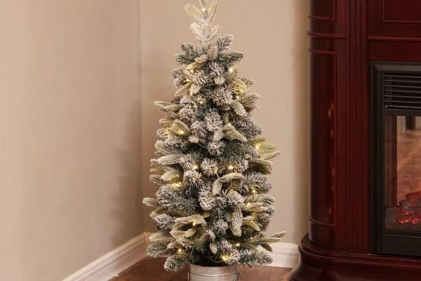 A 3.5 foot flocked Christmas Tree with a galvanized bucket base.