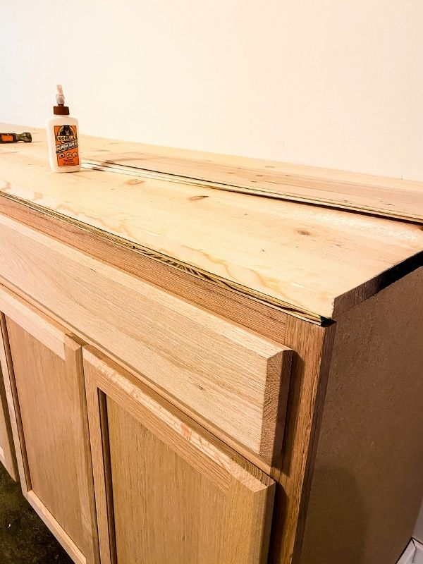 This shows the plywood then the countertop installed on top.