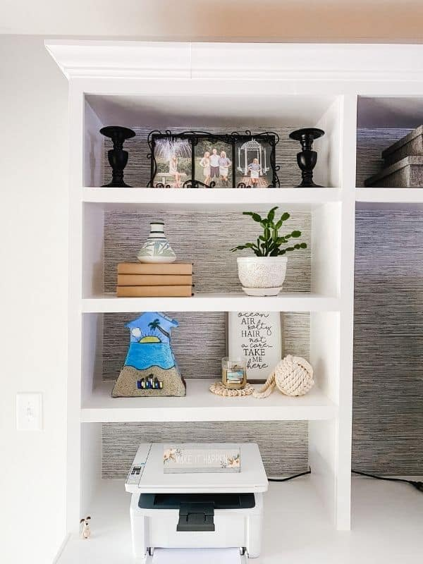The left side of the shelves featuring the decor.