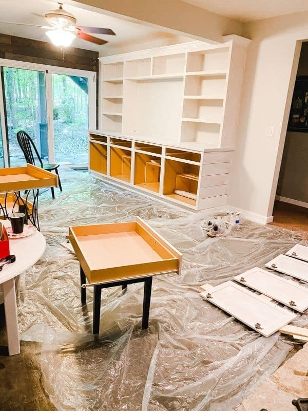 This features the panting process with the doors and drawers removed.