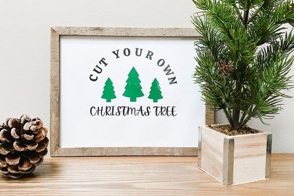 a farmhouse Christmas printable that says cut your own Christmas Tree and has 3 pine trees on it.