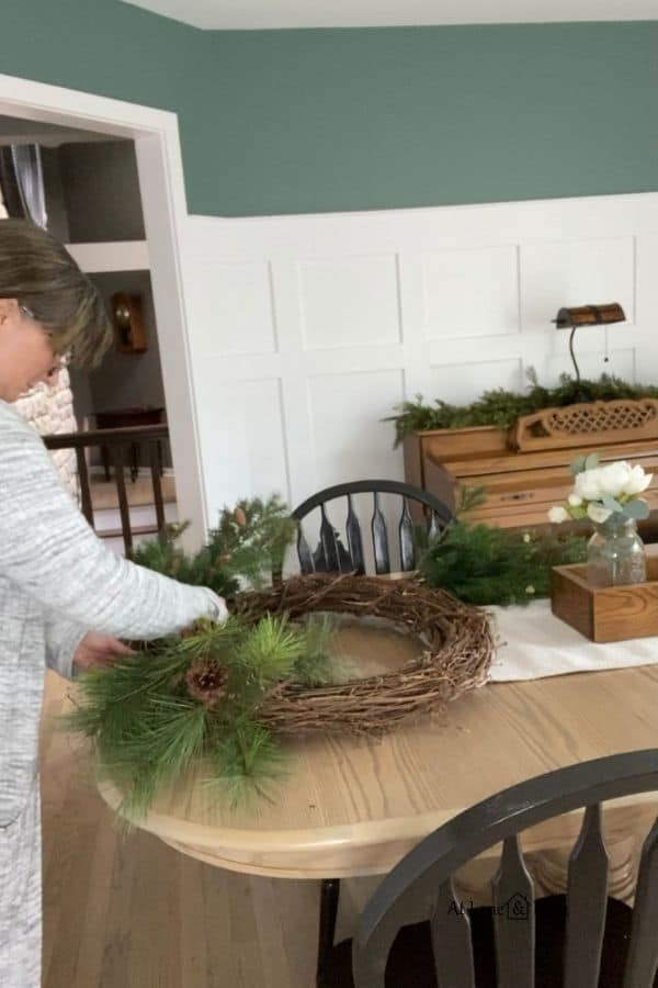 Here I am putting the second sprig into the winter wreath.