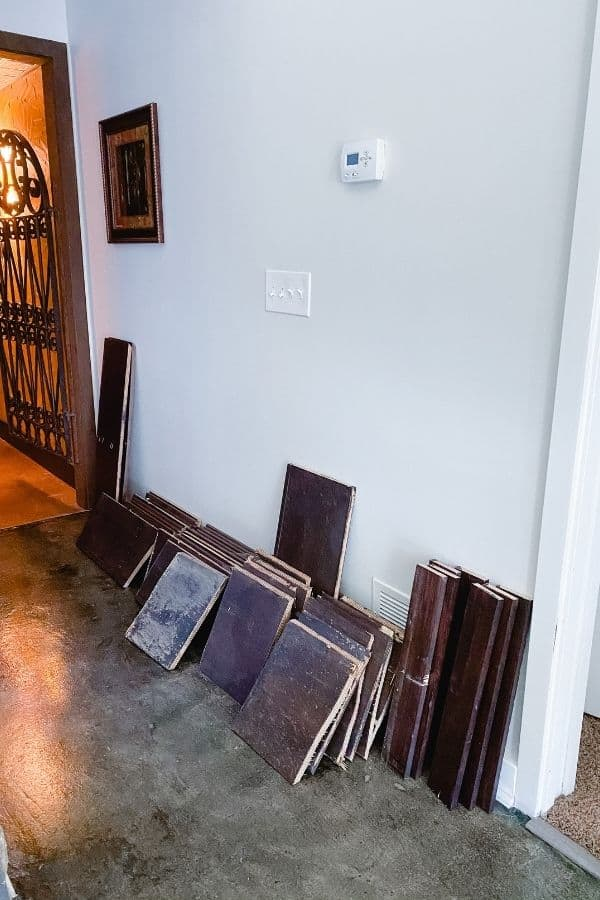 All the wood we removed is stacked in the hallway outside the wine cellar.