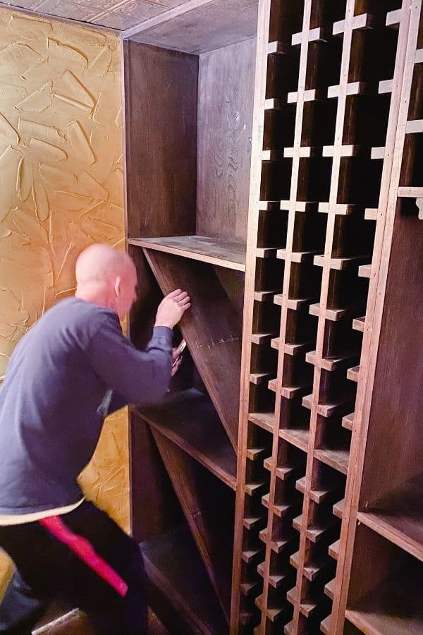 My husband is delicately trying to remove the X shelving for wine.