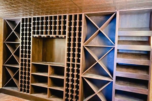 The basement wine cellar with nothing on the shelves.