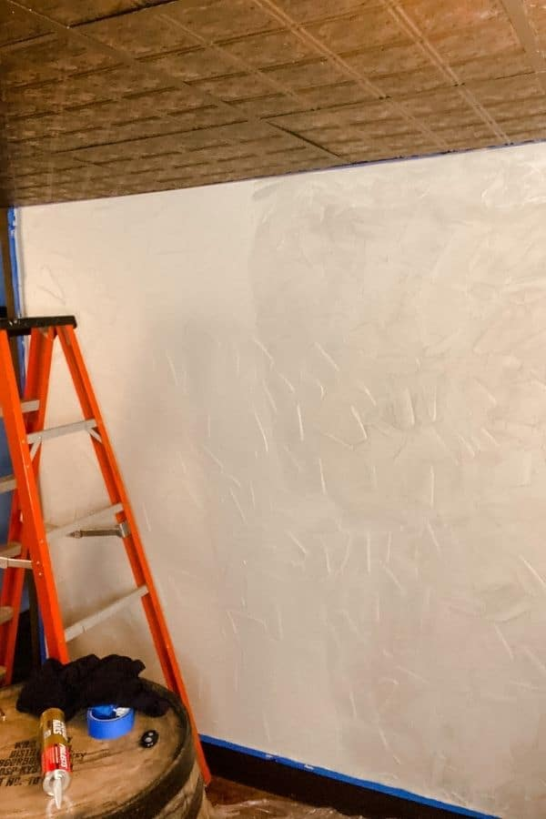 This wall is half painted and half glazed to age the wall in a faux finish.