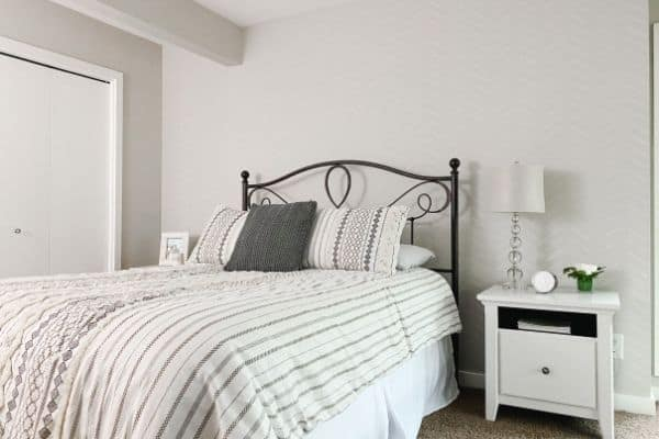 Guest bedroom reveal with the new bedding and herringbone stencil wall.