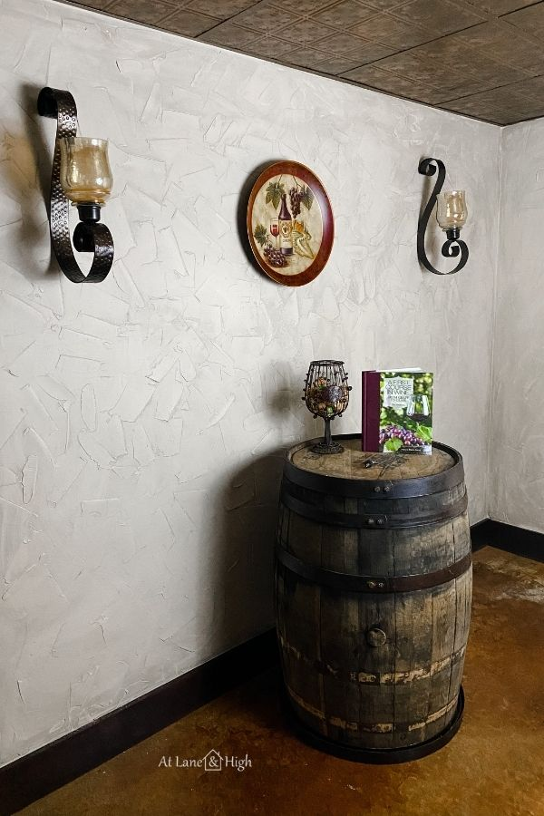 Here are the walls opposite the shelves with the wall sconces, large plate with wine and grapes as well as my Wild Turkey barrel.