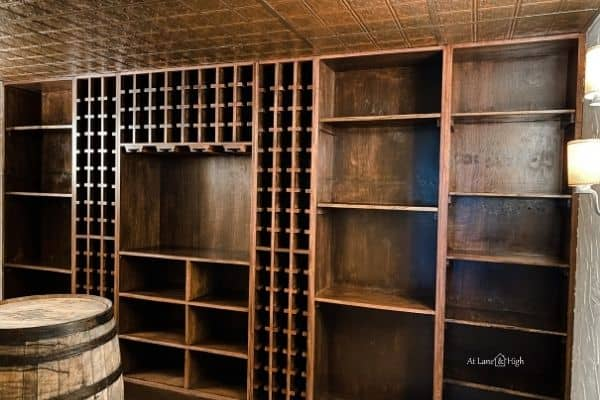 The wine cellar shelving after it was re-installed.  Where there were 4 shelves there are now 12!