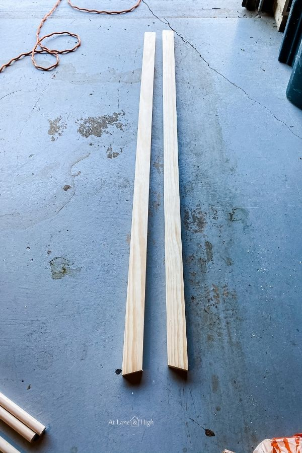 The supports, 1x3's, laying on the garage floor after rimming down and creating an angle for leaning.