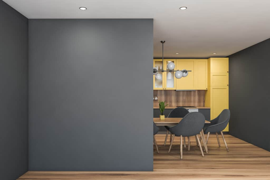 Pantone Ultimate Gray painted on the walls and Illuminating painted on the cabinets of a kitchen.