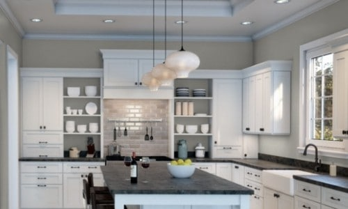 A kitchen painted with Repose Gray and white cabinets and black countertops.