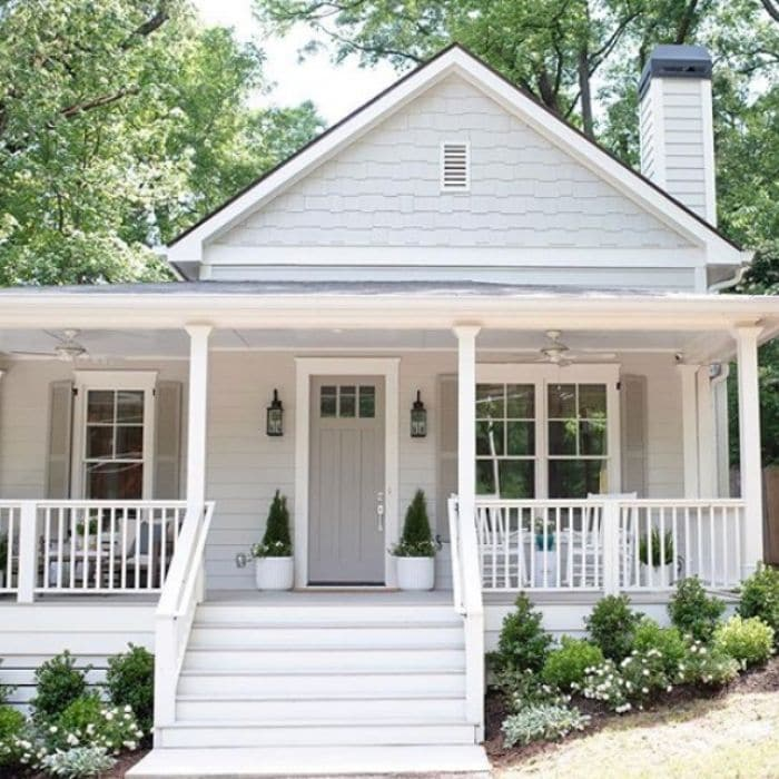 The exterior of a house with repose gray paint and white trim.