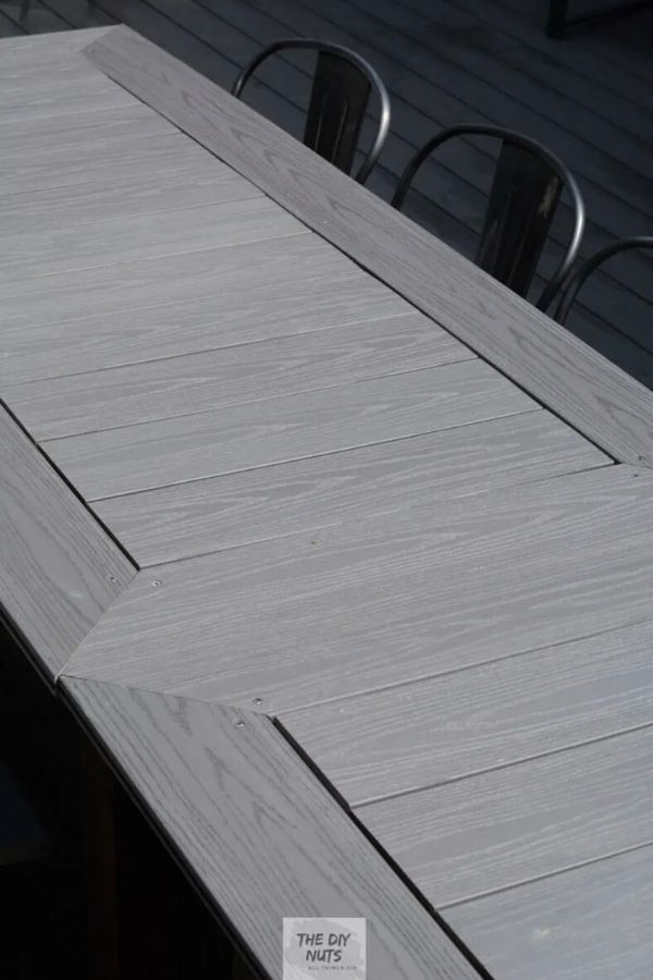 A patio table made using light gray composite decking.
