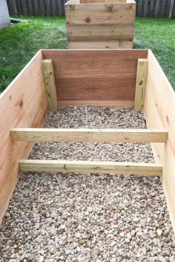 A raised garden bed made using ceder fence posts.