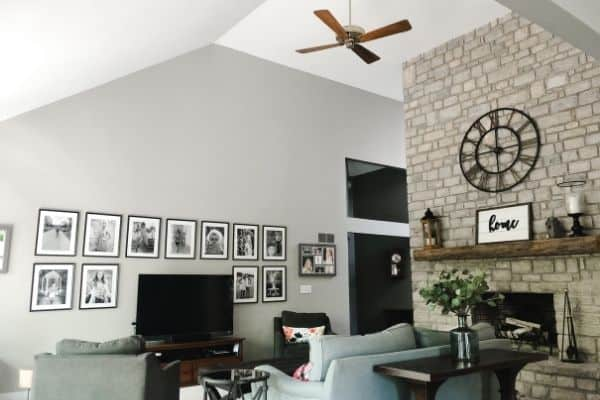 My family room with a dated wood ceiling fan that has no light fixture on it.